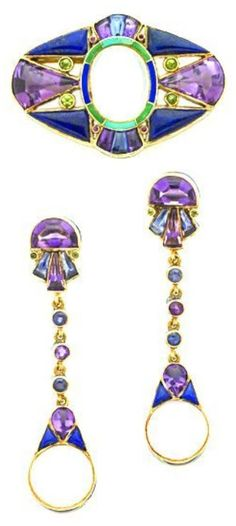 A rare Arts and Crafts gold and gem-set demi parure, by Marie Zimmermann. Consisting of a brooch and a pair of earrings.