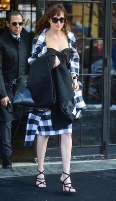 Dakota Johnson Photos Photos - Actress Dakota Johnson is seen leaving her hotel in New York City, New York on February 17, 2015. Dakota was making her way to the 'Late Show with David Letterman' to promote her blockbuster hit, 'Fifty Shades Of Grey.' - Dakota Johnson Leave Her Hotel