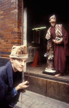 Fashion designer John Galliano with model Jon Evans, photographed in the week he graduated from Central Saint Martin's in London, 1986.