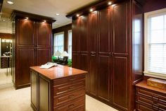 Master Closet With Dark Stained Wood & Island