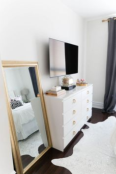 Gold full length mirror & minimal black & white bedroom styling