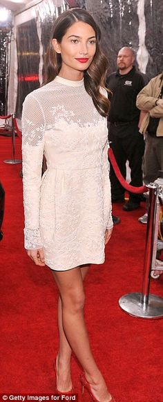 Effortless beauty: Lily Aldridge looked ravishing in her white mini dress and red stiletto heels