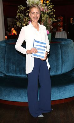 Keeping it simple yet chic, Princess Tatiana of Greece paired blue wide-leg trousers with a white blazer and shirt to present her book, Zu Gast in Griechenland. Rezepte, Kueche & Kultur in Munich, Germany.