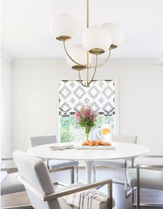 The Carrie Chandelier by Mitzi - Hudson Valley Lighting catches the eye and captures the imagination. This fixture features a staggered bouquet of Opal Etched Glass shades on a glossy Metal column. Resembling a bunch of balloons this chandelier adds a warm glow and really sparkles in a modern space. Shop this look and save 15% during The Design Event. #LumensNewArrivals