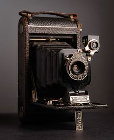 Kodak...looks like the 1928 one of my grandma's.  When we opened it, it had been closed for so many years the accordion paper ripped.....sad.