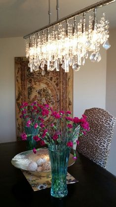 Dining room.  Z GALLERY linear strand crystal chandelier as the focal point Higgins residence