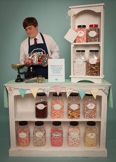 What a fun booth idea for a craft show. Could display anything in place of candy jars. Bust forms with necklaces or scarves, purses, soaps, etc.