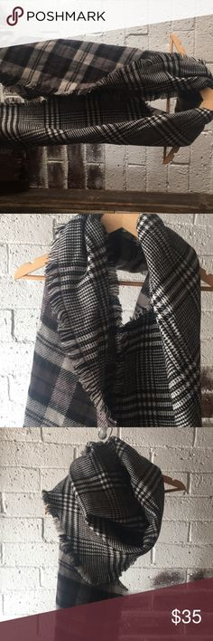 Large scarf Super soft black and white checkered on one side and black and grey on the other. Never worn Anthropologie Accessories Scarves & Wraps