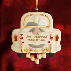 1st married Christmas together ornament by Lenox. hand painted fine china. So sweet with the getaway car, bride and groom, the cans, and the personalized sign :) Definitely adding it to our tree this Christmas <3