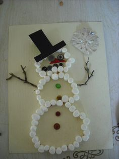 Easy preschool snowman craft using mini marshmallows