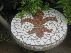 Made with broken tile on a concrete stepping stone!