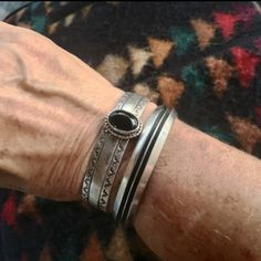 Striking sterling silver cuff bracelets. Perfect to mix and match or solo. Made by American Indian jewelers.