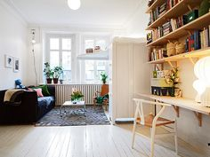 I'm afraid of platform beds like these (yep, it's at the top of that wardrobe!), though I can't help but love how this little apartment was put together. #apartment #small_space