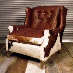 "Stetson Chair, $1,745, now featured on Fab.  Tony sez...wow! at that price it looks like I'll be sneaking into one of the local cow farmers and um...""borrow"" one of the local heifer's...I mean how heavy can they be? (sez the guy from the Bronx ;_D)"""