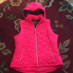BNWOT HOT CORAL Puffer Vest SZ XL This is a brand new never worn lightweight puffer vest. Zip off hood, hand pocket zippers and great for packing. Super lightweight yet warm. Color is bright coral/ hot pink- prettier in person. Fits more like a loose Medium. I'm a size 6-8 and fits me perfect with sweater. Tek Gear Jackets & Coats Vests
