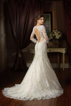 DETAIL DESCRIPTION This gown oozes luxury. Layers of beautiful Alençon lace on top of tulle gives off a airy extravagance. The V-neck neckline and fit and flare skirt elevates this dress to a new level of class, fit for the finest weddings.