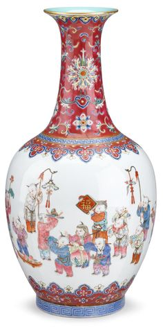 Chinese famille rose porcelain 'boys' vase, Daoguang mark and of the period. The oviform body finely enamelled with boys at play; some boys are shown carrying large fruits such as peach, pomegranates and lychee, others with lanterns, lotus flowers, musical instruments, fu character and other auspicious objects; between ruyi borders; the tall waisted neck painted with flower sprays reserved on a ruby ground, the interior of the neck in turquoise enamel. #FreemansAuction