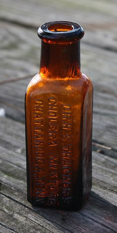 Thacher's Cholera Mixture - amber, tooled lip, 3 5/16in (85mm) tall. Embossing: DR. H. S. THACHER'S / CHOLERA MIXTURE / CHATTANOOGA, TENN - 1890s