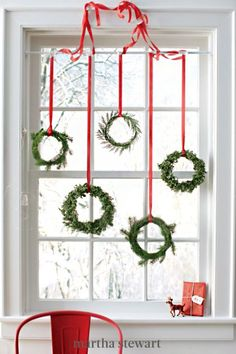 Turn fallen branches of greenery into simple yet charming mini-wreaths. Add a pop of color with cheery red ribbon and, soon, every window in your house will be dressed with one. #marthastewart #christmas #diychristmas #diy #diycrafts #crafts