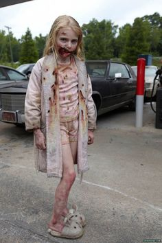The Zombie Girl from The Walking Dead pilot episode. Also (I THINK)  the first zombie of the series that we saw.