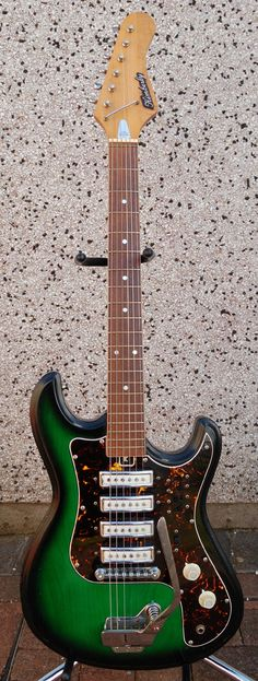 A rare and eye catching Kimberly vintage guitar in Trans Green Burst.