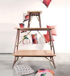 The Dualtone collection is a sterling matrimony between the combination of bright American oak and dark American walnut. Designed with mid-century modern flavours and topped off with a tinge of pale brass, create the ideal, bright Scandinavian look for the home with the dual-toned end table, console table and coffee table. Seen stacked here as a furniture Christmas tree with colourful cushions!