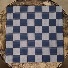 Eco-friendly Chess Board Cushion Cover  This cushion cover is made from eco-friendly handloom denim, and is completely hand-stitched on a foot pedal operated vintage sewing machine, by a seasoned tailor.  The chess-board design, made by interlacing strips of denim fabric, is an ever-green design, and has a mesmerizing effect.  The darker color is the face of the fabric, and the lighter one comes from the back of the fabric. The fabric is true 3x1 twill weave, made from 100% cotton singles…
