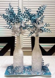 "I created this ""Winter Wonderland"" centerpiece out of old wine bottles!"