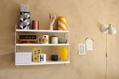 String pocket-shelf with yellow goodies!
