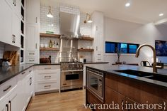 I really like the tall skinny counter to ceiling cabinets with the open floating shelves. Unusual and Perfect. veranda interiors: Altadore I {Kitchen}