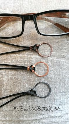 This listing is for one handcrafted eyeglass necklace. This necklace is made with solid copper which has been hammered, textured and shaped. Your choice of shiny copper, antiqued copper, or a rustic brown gunmetal grey. The cord is made of quality leather which can be adjusted to any length that works best for you making it a very versatile necklace. Please note over time each copper loop necklace will devlop a rustic and time-worn finish adding to its uniqueness and style. A great birthday…