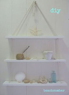 DIY shelves from pallet or other scrap wood. I like the shelves, not so much the beach decor.