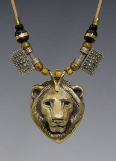 Bronze Lion w/ Smoky Quartz Eyes, African Kazuri and Telsum Beads on leather cord | Brooke Stone Jewelry