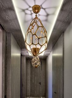 I love how the bulb in this fixture is hidden, directing the light up and creating a shadow pattern on the ceiling. @sakDesign