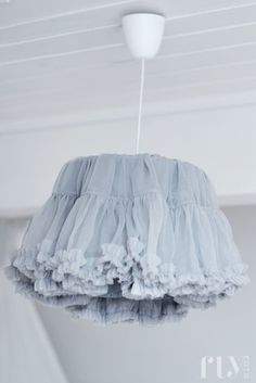 .fluffy skirt used as a lamp shade
