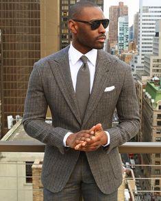 Men's grey blazer, grey dress pants, grey tie, white oxford shirt, white pocket square