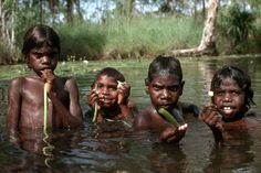 Photos of Aboriginal children from Northern Australia, learning and playing, looking after themselves and each other, self-sufficient at an early age. Aboriginal Culture, Aboriginal Art, Aboriginal Children, Australian Aboriginals, Famous Philosophers, Kids Around The World, Travel Around Europe, Australia Photos, Black History Facts