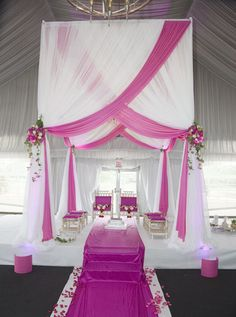 Pretty pink and white wedding drapes perfect for a spring wedding.