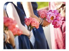100% I want my bridesmaids holding coral flowers    Navy blue bridesmaids' dresses, coral flowers