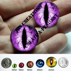 Glass Eyes - 24mm - Purple Dragon Taxidermy Eye Cabochons for Steampunk Jewelry and Pendant Making, $9.00 --- These purple dragon eyes are made of glass with an image transfer technique. They measure 24mm. These glass eyes can be used with polymer clay, altered art and steampunk jewelry making. Not suitable for PMC or kiln work.