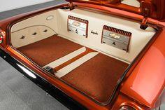 61 Chevrolet Impala, burnt orange ls6 ls swap. asanti 5 star af144 wheels, jl audio amps with chevy bowtie badges trunk