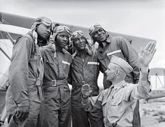 Members of the U.S. Army Air Corps' legendary 99th Pursuit Squadron, the Tuskegee Airmen, receive instruction about wind currents from a lieutenant in 1942. The Tuskegee fliers — the nation's first African American air squadron — served with distinction in the segregated American military.