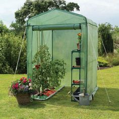 Portable greenhouse--something like this would save me a lot of time & effort hauling seedlings in & out in the spring