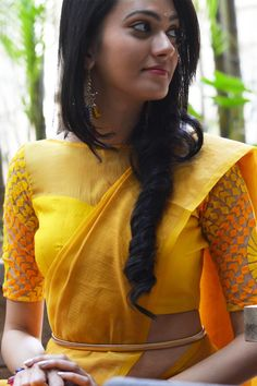 How cool is this website. DESCRIPTION: Classic yet quirky, a sunshine yellow blouse which combines three fabrics in the same colourFABRIC:Body - Yellow raw silkYoke - Yellow chiffonSleeves - Yellow