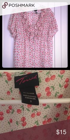 Adorable, cherry-print top (Torrid size 2) This super sheer, and adorable, cherry-print top is just waiting to find a new closet to call home. Lovingly worn, it's a perfect top for the spring and summer or to layer up and add some cheer to these gloomy winter days. From a cigarette-free, pet-friendly home. torrid Tops Blouses