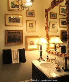classic • casual • home: Beautiful Lakeside Living in Florida. Frames art gallery wall in bathroom.  Table lamp on sink vanity, gold gilded mirror hung above the sink.