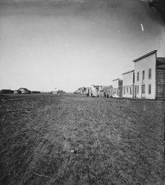 Linda Slaughter described Bismarck as a growing city with a vigorous business district. This photograph shows downtown Bismarck in 1874. The city had dirt streets and wood framed buildings. Many of the businesses were saloons.