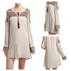 Blue Pepper Long Sleeve Natural Dress This long sleeve nude dress with burgundy embroidery is a great addition to anyone's closet. The lace up V neck gives the dress a little something extra. Pair with your favorite fall boots for work or play. Blu Pepper Dresses Mini