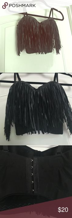 Black faux leather fringe crop top push up corset Perfect Condition worn one time for a few hours a s a Halloween costume. It's a adjustable corset fastens in the back. also has a lightly built in padded push up. Just Adorable Tops Crop Tops