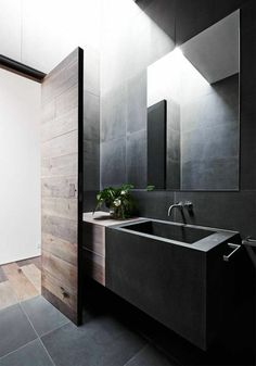modernes badezimmer schwarze einrichtung pflanzen